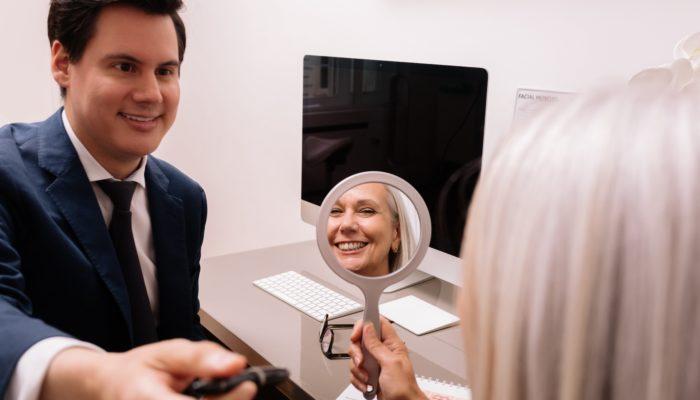 patient consult raul mirror smiling