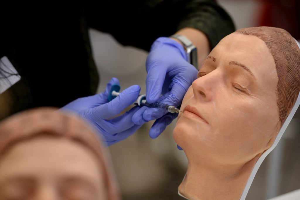 Injecting Lip Filler Safely New Injector Training Harley Academy Mannequin practice in Foundation Training - Lip Fillers